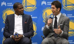 OAKLAND, CA - JULY 07: Kevin Durant sits with general manager Bob Myers of the Golden State Warriors while they speak to the media during the press conference where Durant was introduced as a Golden State Warrior after they signed him as a free agent on July 7, 2016 in Oakland, California. (Photo by Thearon W. Henderson/Getty Images)